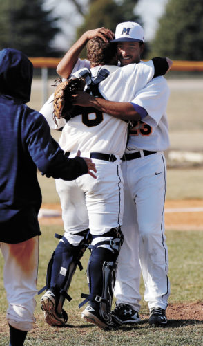 T-R PHOTO BY ADAM RING • MCC pitcher Juan Carlos Gonzalez (23) hugs catcher Max McCay after Gonzalez completed throwing a five-inning no-hitter in game two of a doubleheader against Milwaukee Area Technical College Sunday afternoon at Shawn Williams Field. Gonzalez allowed no walks and struck out nine in the 14-0 win.
