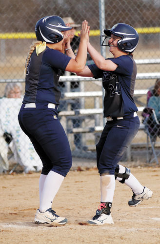 T-R PHOTO BY ADAM RING • Marshalltown Community College softball players Josie Carpenter, left, and Lexy Gatewood (24) celebrate after Gatewood scored the game-winning run in the bottom of the seventh innning in the second game of a doubleheader against Ellsworth Community College Monday at MCC. The Tigers won both games 9-8 and 7-6.