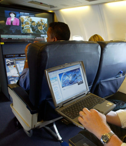 AP PHOTO This is a July 29, 2002 file photo of  a laptop is used on a plane. On Tuesday, Britain's government banned electronic devices in the carry-on bags of passengers traveling to the U.K. from six countries, following closely on a similar ban imposed by the United States.