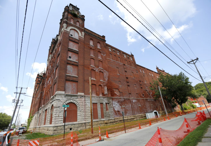 AP PHOTO An Aug. 3, 2016 photo shows the H&W building at the corner of Jackson and E. 30th streets in Dubuque. A Cedar Rapids developer has bought the historic, crumbling former brewery in Dubuque, offering hope of saving a landmark that once was among the largest brewers in the country.