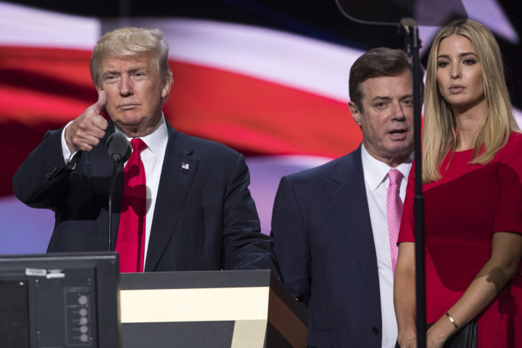 AP PHOTO In this photo taken July 21, 2016, then-Trump Campaign manager Paul Manafort stands between the then-Republican presidential candidate Donald Trump and his daughter Ivanka Trump during a walk through at the Republican National Convention in Cleveland.