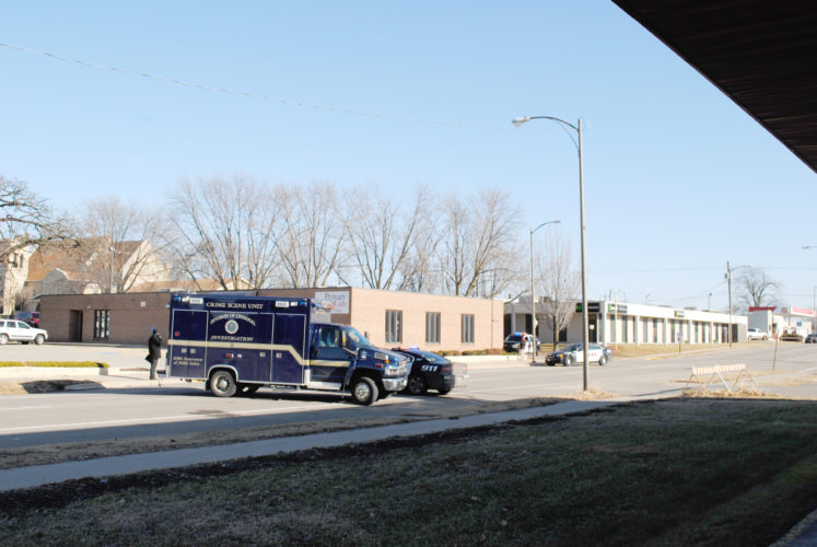 T-R FILE PHOTO  From a Dec. 18, 2014 file photo, a Iowa Division of Criminal Investigation Crime Scene Unit with Marshalltown Police Department vehicles are shown near the area of Second Avenue and Linn Street. The DCI was called to the scene as as a result of a 3:47 a.m. Dec. 17 shooting involving armed suspect Andrew Worsfold and MPD officers Ramon Maxey and Benjamin Scheevel. Worsfold was killed in the incident. Law enforcement personnel were seen examining an area near the CIRSI parking lot and the southwest corner of Primary Health Care.