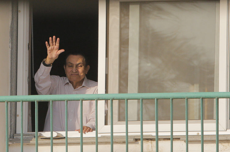 AP PHOTO In this Oct. 16, 1016 file photo, ousted Egyptian President Hosni Mubarak waves to his supporters from his room at the Maadi Military Hospital as they celebrate the 43rd anniversary of the Oct. 6, 1973 war. An Egyptian security official said Friday, that the country's ousted President Hosni Mubarak returned home, after his release.