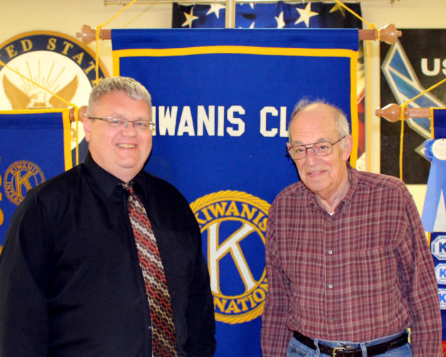 CONTRIBUTED PHOTO  Eric Goslinga, left, is welcomed to the Tuesday Noon Kiwanis meeting by member Jim Bacino. Goslinga presented a program on the Sea Cadet organization and the Marshall County cadets.