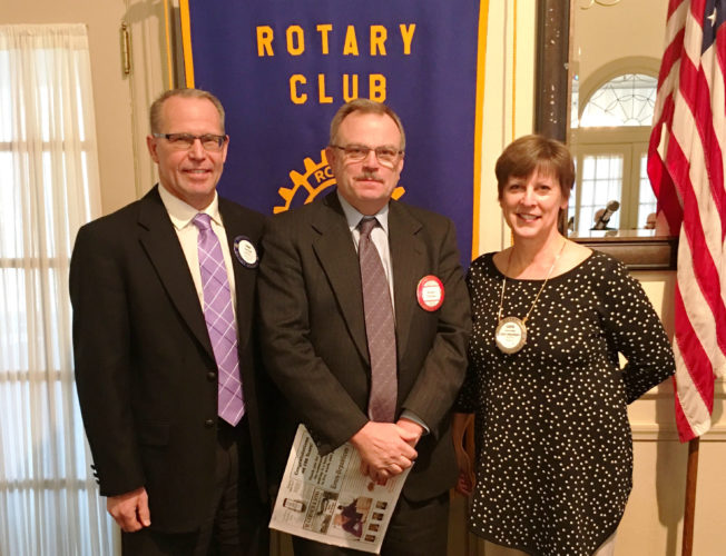 CONTRIBUTED PHOTO Past-president Carol Hibbs and sponsor Curt Hoff are seen with Robert Thomas (center), the most recent member inducted into the Marshalltown Rotary club.