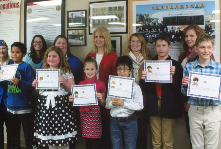 CONTRIBUTED PHOTO Elementary students with winning essays are from left to right: Jacob Hayes, Lauren Keller, Raegan Tolle, Michael Martinez, William Grommet and Saxon Hancock. Back row, left to right: Deloris Clayton, Post 839 contest chairperson; Tammy Hayes, Home School teacher; Melissa Keller, Home School teacher; Hollee Tolle, Home School teacher; Mrs. Boone, St. Francis teacher; absent because of illness was Mrs. Davis, St. Francis teacher, and Kari Hancock, Home School teacher.
