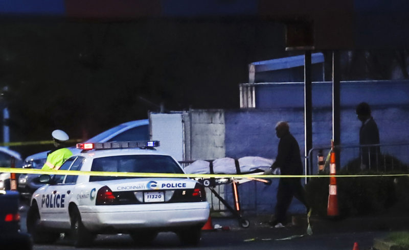 A body is removed as police work at the Cameo club after a fatal shooting, Sunday, March 26, 2017, in Cincinnati. (AP Photo/John Minchillo)