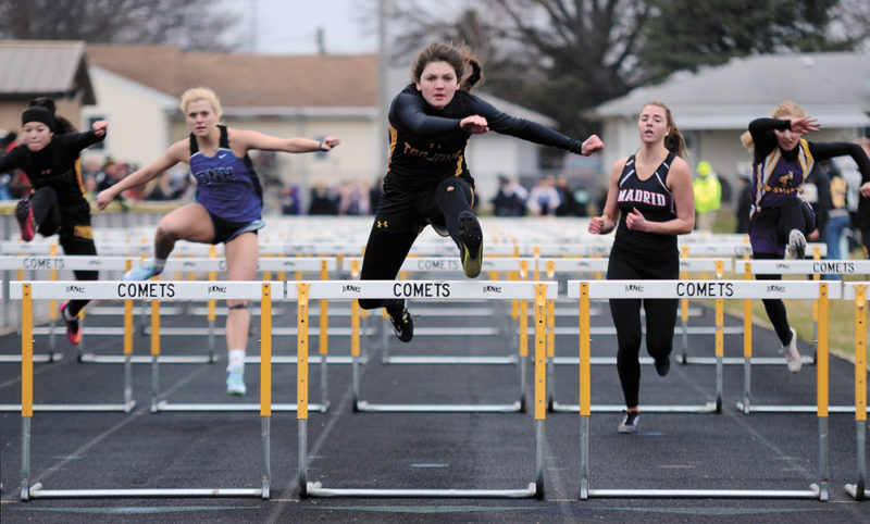 T-R PHOTO BY STEPHEN KOENIGSFELD • Isabelle Gradwell leaps over her final hurdle and heads for the finish line in the 100-meter hurdles Monday afternoon at the 2017 Comet Girls' Early Bird meet. Gradwell was first in the event with a time of 16.45 seconds, and helped the Trojans to a first-place finish.