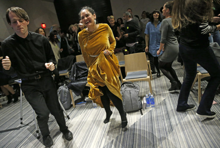 AP PHOTO In this March 8 photo, Andrew Hoepfner, left, and Pamela Martinez, center, dances along with participants at a sober social event sponsored by The Shine at a hotel in Brooklyn, New York. Alcohol-free events, which are popping up in New York, Los Angeles and Chicago, are part of a trend fueled by millennials seeking to find meaningful connections while they party.