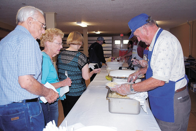 T-R FILE  PHOTO From this Sept. 26, 2014 file photo, Larry Kester serves Char Mayer and Leland Wiseman, both of Marshalltown, during the Matins Kiwanis annual spaghetti dinner during the  Oktemberfest celebration at Veterans Memorial Coliseum. Oktemberfest makes extensive use of the VMC during its four-day run.