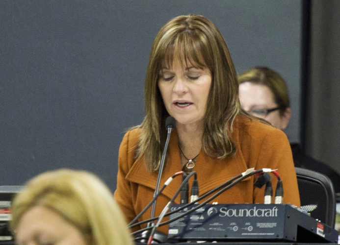 """AP PHOTO In this Nov. 15, 2015 photo, Geri Huser, chairwoman of the Iowa Utilities Board, speaks during a hearing in Boone. A review by The Associated Press shows that Huser maintained a busy and profitable private legal practice even though a law mandates she devote her """"whole time"""" to state business."""