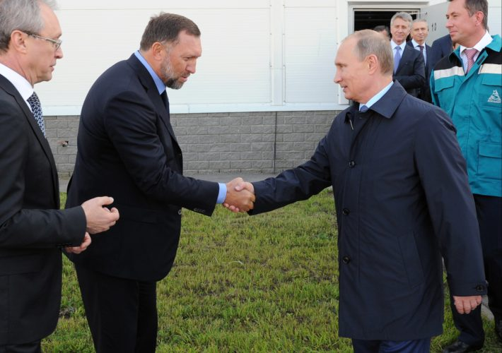 AP PHOTO In this Sept. 19, 2014 file-pool photo, Russian President Vladimir Putin, right, shakes hands with Russian metals magnate Oleg Deripaska while visiting the RusVinyl plant in Kstovo, in Russia's Nizhny Novgorod region. Deripaska says he is willing to take part in U.S. congressional hearings to discuss his relationship with President Donald Trump's former campaign chairman, Paul Manafort.