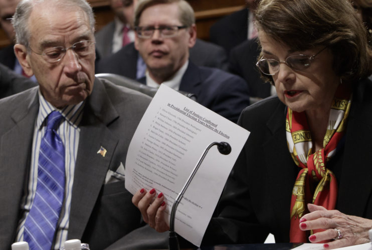 AP PHOTO Senate Judiciary Committee Chairman Sen. Charles Grassley, R-Iowa, center, listens as the committee's ranking member, Sen. Dianne Feinstein, D-Calif. requests a one week postponement for the panel to vote on Supreme Court nominee Neil Gorsuch, as she displays a list of appointments made during presidential election years, Monday, on Capitol Hill in Washington.