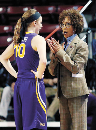 AP FILE PHOTO • Northern Iowa basketball coach Tanya Warren, right, talks with guard Ellie Herzberg (10) during the Panthers' first-round game against DePaul in the women's NCAA Tournament on March 17 in Starkville, Miss. DePaul won 88-67.
