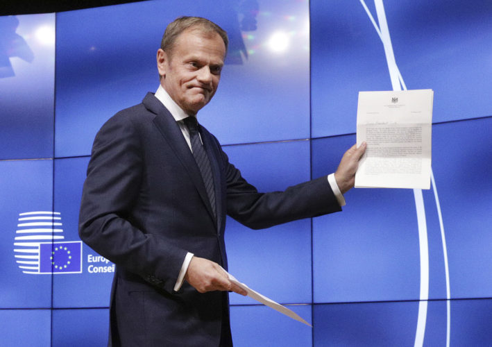 AP PHOTO EU Council President Donald Tusk grimaces at a press conference in Brussels, Belgium, Wednesday, showing the letter he received signed by Britain's Prime Minister Theresa May formally triggered the beginning of Britain's exit from the European Union.