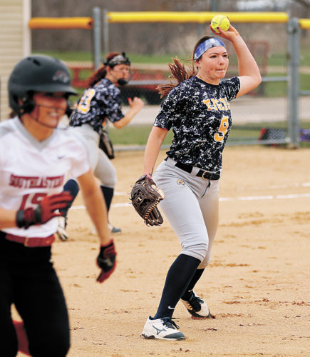 T-R PHOTO BY ADAM RING • Marshalltown Community College pitcher Jordan Carter, right, throws to first after fielding a groundball to get Southeastern Community College's Courtney Coffin, left, out in the second game of a doubleheader Saturday afternoon. MCC fell in both games, 6-3 and 8-5.