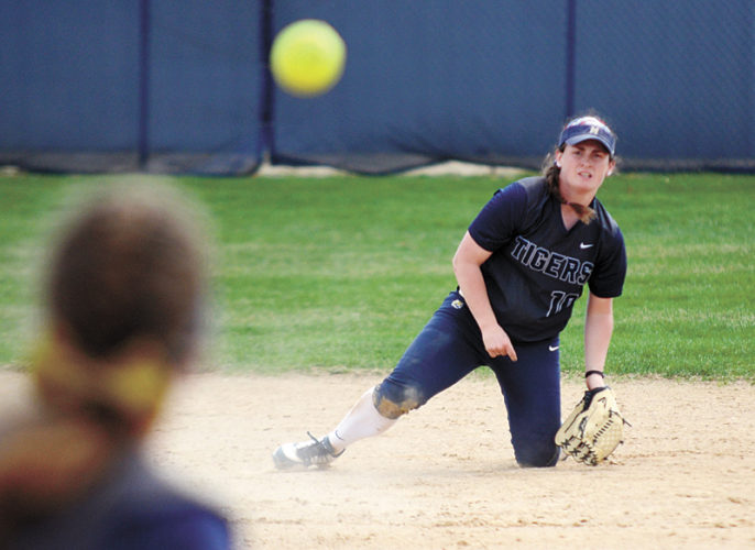 T-R PHOTO BY STEPHEN KOENIGSFELD • Shortstop Courtney Fudge thorws a ground ball to first baseman Tess Cheetham during a contest in Sunday's double header against Indian Hills Community College. Fudge was 4-for-7 with a double between the two games, as MCC dropped both conference contests.
