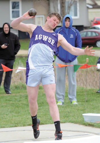 T-R PHOTO BY STEPHEN KOENIGSFELD • AGWSR's Caleb Meinders throws one of his tries during the shot put event at Monday's East Marshall Boys' Invitational. Meinders won the shot put with a throw of 52 feet, 5 inches.
