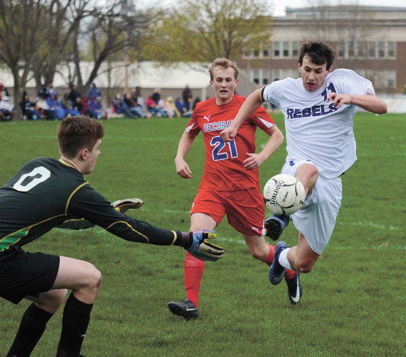 T-R PHOTO BY STEPHEN KOENIGSFELD • Grundy Center/Gladbrook-Reinbeck forward Erik Knaack (11) works to take a shot against Decorah goalkeeper Avery Dugger, left, in the first half of Thursday night's game against the Vikings in Reinbeck. Knaack scored both goals in the third-ranked Rebels' 2-0 win.