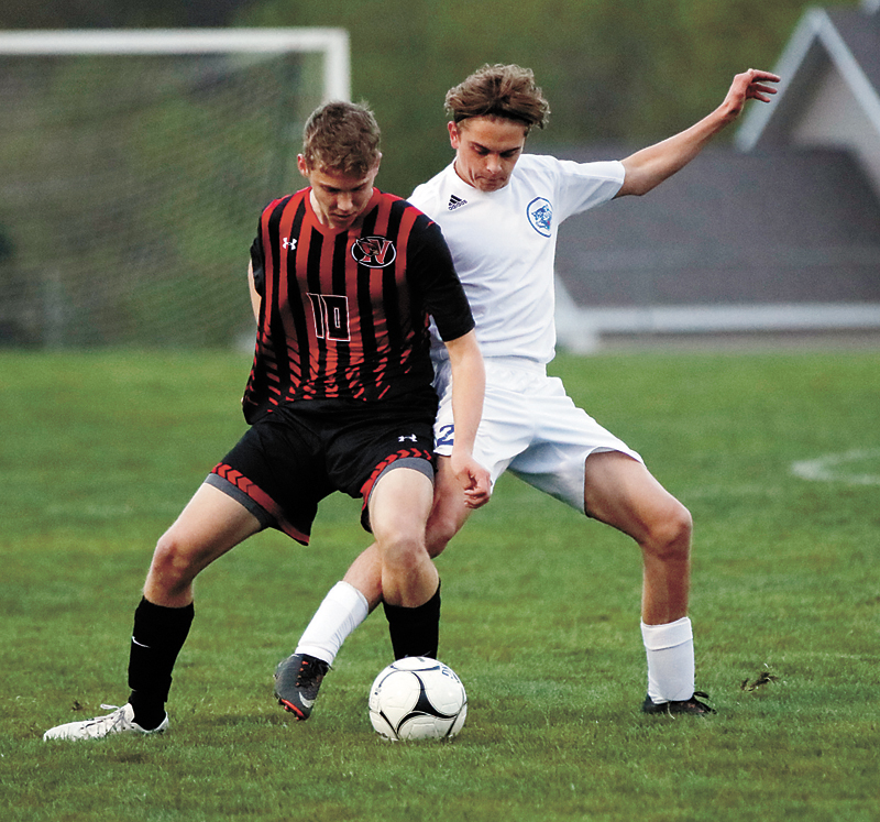 T-R PHOTO BY ADAM RING • Marshalltown's Nick Summers, right, and Newton's Josh Ventling fight for possession of the soccer ball in the first half Thursday at Leonard Cole Field. Newton came away with the 2-1 overtime win.