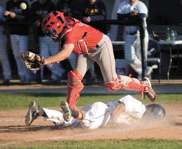T-R PHOTO STEPHEN KOENIGSFELD • Jalen Horton slides head first into home plate in the bottom of the seventh inning, in game two, against Southwestern CC catcher Jared Heman. Horton was safe, but the Tigers failed to come back, falling 6-2 in the nightcap. The Tigers won 8-6 in the first game.