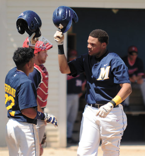 T-R PHOTO BY STEPHEN KOENIGSFELD • Luis Duran celebrates with teammate Marving Serrano, left, after hitting his first of three home runs Sunday, helping him go a collective 5-for-8 on the afternoon. The Tigers lost, however, in the doubleheader with Southwestern Community College, 8-5, 8-4.