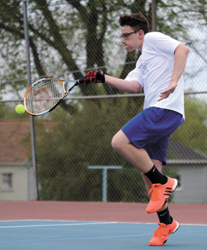 T-R PHOTO BY STEPHEN KOENIGSFELD • Frank Iole returns a volley during his singles match Tuesday night. Iole won in his second varsity start, 6-4, 6-2, helping the Bobcats to an 11-0 win against Des Moines Hoover.