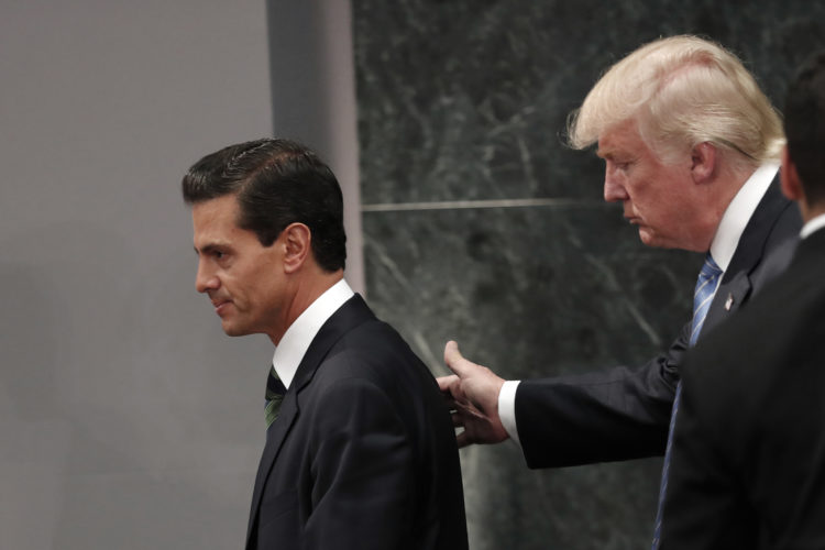 AP PHOTO In this Aug. 31, 2016 file photo, Republican presidential nominee Donald Trump walks with Mexico President Enrique Pena Nieto at the end of their joint statement at Los Pinos, the presidential official residence, in Mexico City. Like the rest of the world, Mexico only learned through media reports on Wednesday, that the Donald Trump Administration was considering a draft executive order to withdraw the United States from the North American Free Trade Agreement.