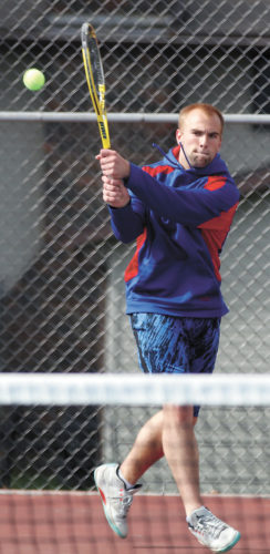 T-R PHOTO BY ADAM RING • Marshalltown's Jacob Rachuy makes a backhand return during singles play in Thursday's CIML Iowa Conference meet against Johnston at the MHS Tennis Courts. Rachuy and Sam Brintnall got a win at No. 2 doubles, but the Bobcats lost 8-3 to the visiting Dragons.
