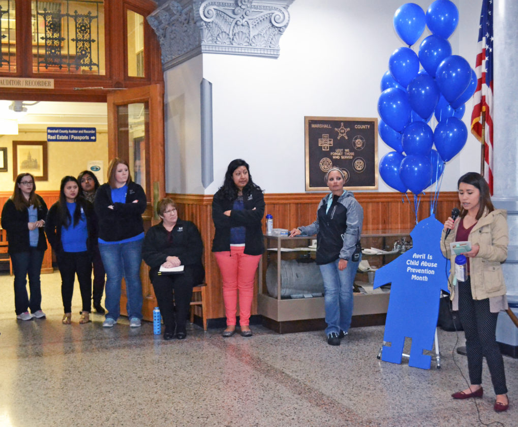 T-R PHOTO BY SARA JORDAN-HEINTZ Friday afternoon, inside the Marshall County Courthouse rotunda, the public gathered for a special rally sponsored by CAPS, in recognition of April being Child Abuse Prevention Month. Representatives from CAPS and other local agencies, shared stories of their work fighting this societal struggle. Jocelyn Hernandez of ACCESS, far right, spoke about her role in helping a woman with a young child leave an abusive relationship.