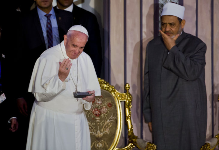 AP PHOTO Pope Francis, flanked by Sheikh Ahmed el-Tayeb, right, Grand Imam of Al-Azhar, the pre-eminent institute of Islamic learning in the Sunni Muslim world, greets participants in an International peace conference, in Cairo, Egypt, Friday.