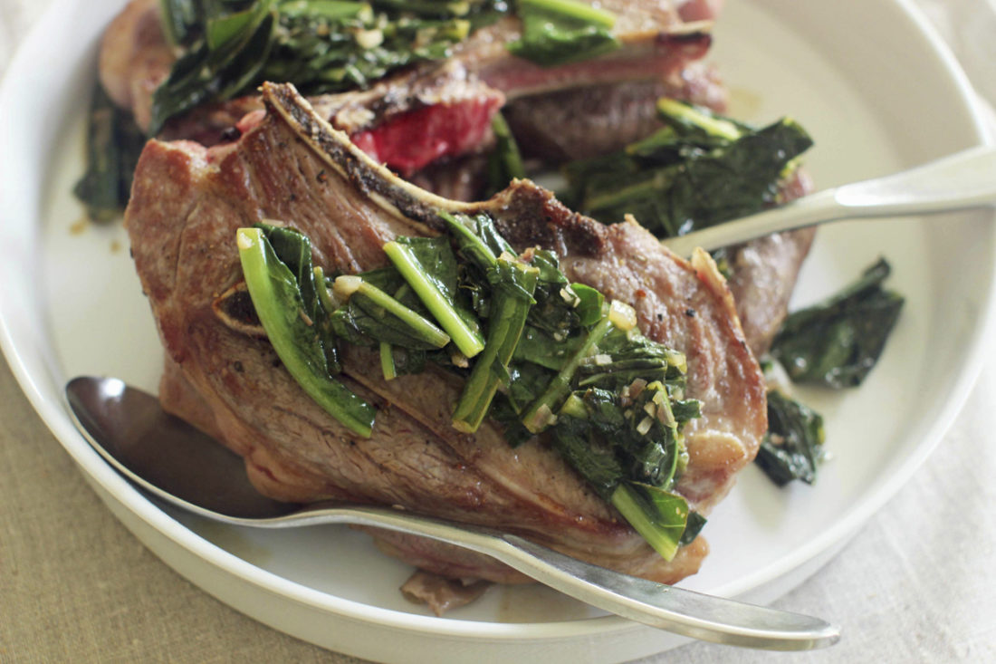 FILE - This July 27, 2015 file photo, shows lamb chops with warm Caesar salad in Concord, N.H. This dish is from a recipe by Sara Moulton. (AP Photo/Matthew Mead)