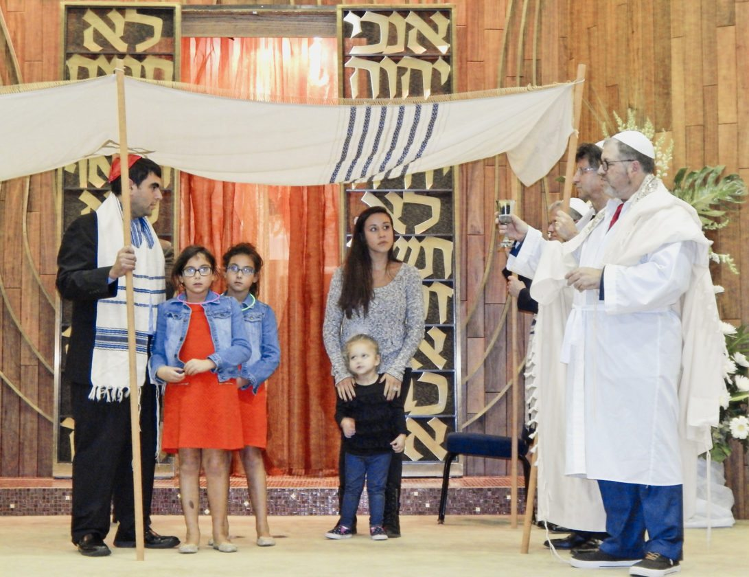 Tribune Chronicle / Bob Coupland Rabbi Joseph Schonberger, right, blesses children Wednesday at Temple El Emeth in Liberty to mark the conclusion of Yom Kippur, the Jewish Day of Atonement. The event also included the sounding of the shofar, or ram's horn, by several members. Jewish people traditionally observe the holy day of Yom Kippur with a 25-hour period of fasting and intensive prayer, often spending much of the day in synagogue services.