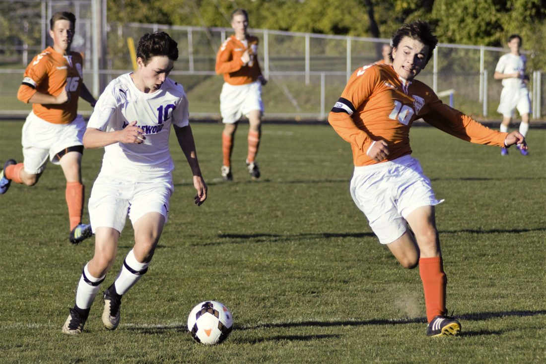 Tribune Chronicle / Bob Ettinger  Evan Hunter (left) of Maplewood and Kevin Piczer of Newbury race to the ball in a 2-2 draw on Wednesday evening at Maplewood.