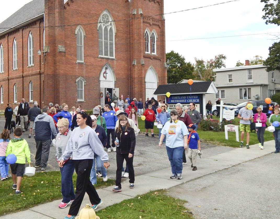 More than 75 people took part in the annual Crop Walk held in Cortland with the theme ''End Hunger One Step at a Time.'' People representing 12 churches took part in the event.