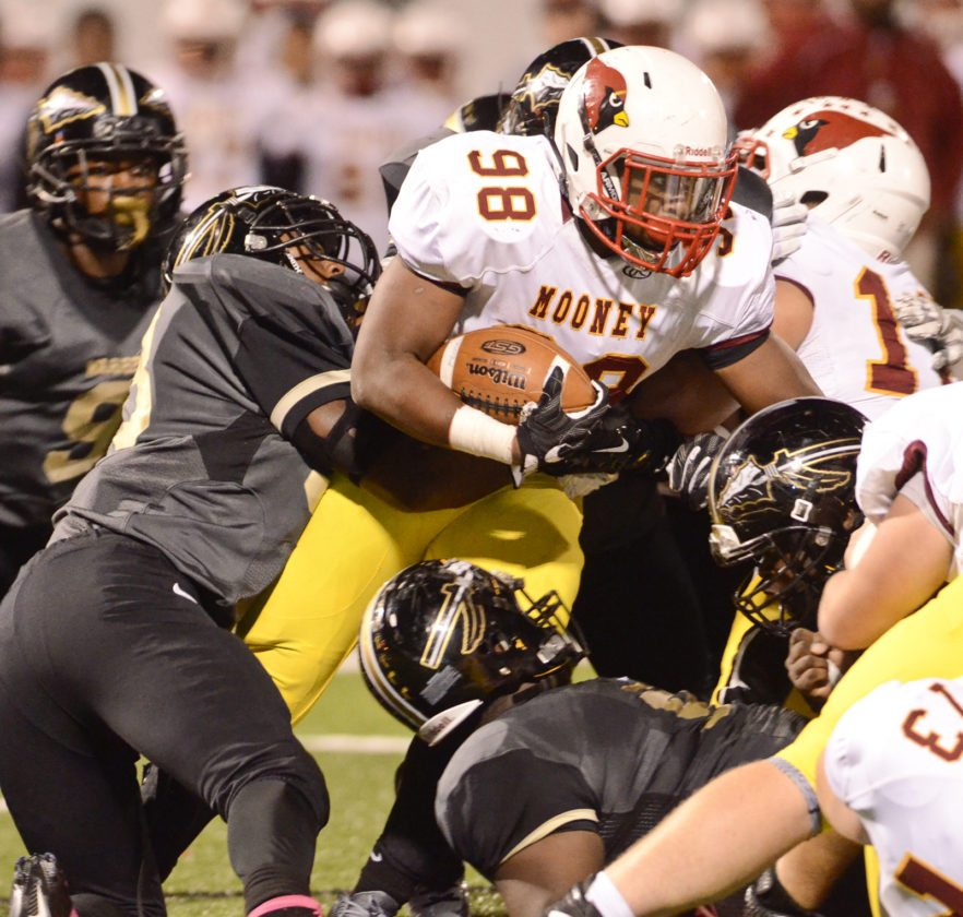 WGH defense gang tackles Mooney #89 Ray Anderson during 1st half action...by R. Michael Semple