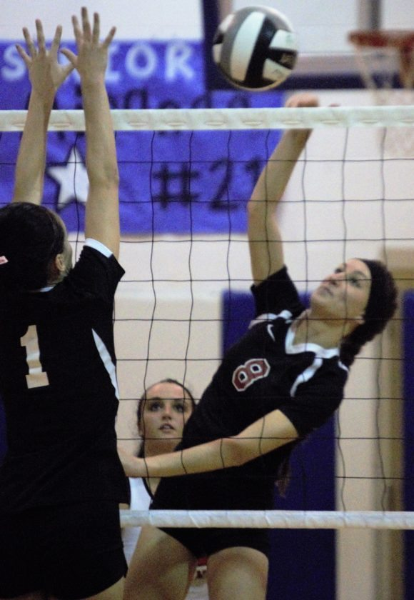 Paige Sponsler of Mathews spikes around the block of Lexi Knight of Windham in the MustangsÕ three-game victory in a Division IV sectional semifinal on Monday night at Lakeview.