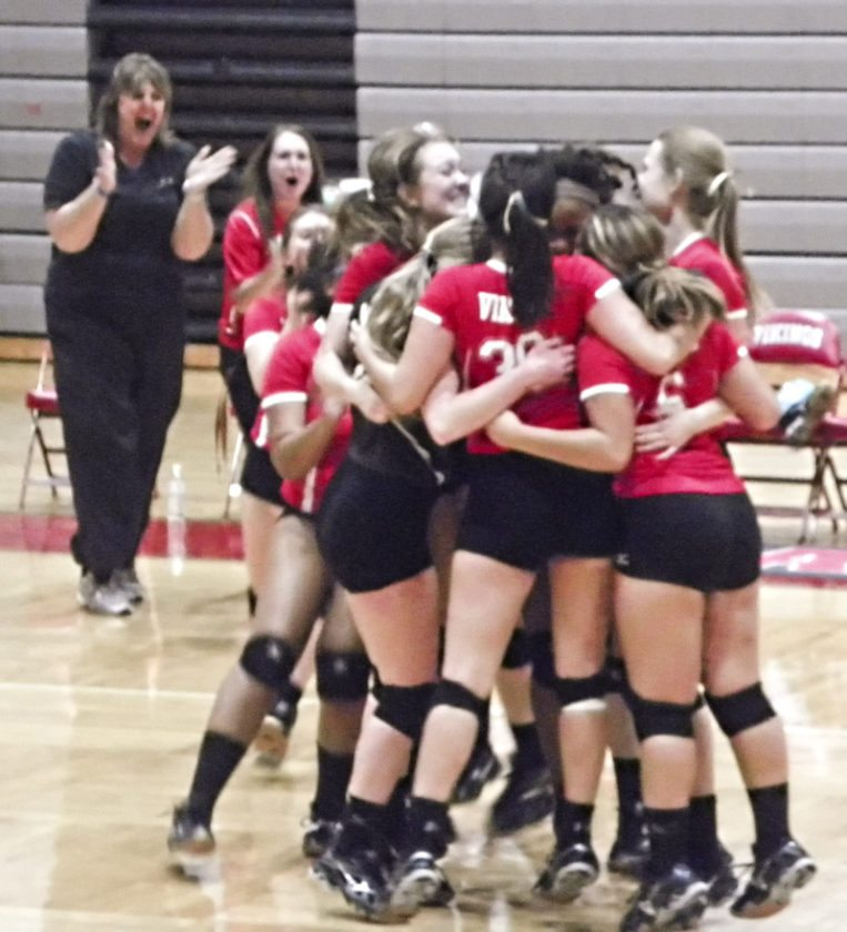 Tribune Chronicle / Eric Murray Members of the LaBrae volleyball team celebrate their victory Tuesday over Brookfield.