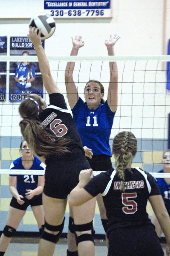 Tribune Chronicle / Bob Ettinger  Andrea Sparks (11) of Maplewood goes up to block the spike of Mathews' Sadie Bertock in the Mustangs' four-set victory in a Division IV sectional match Wednesday at Lakeview.
