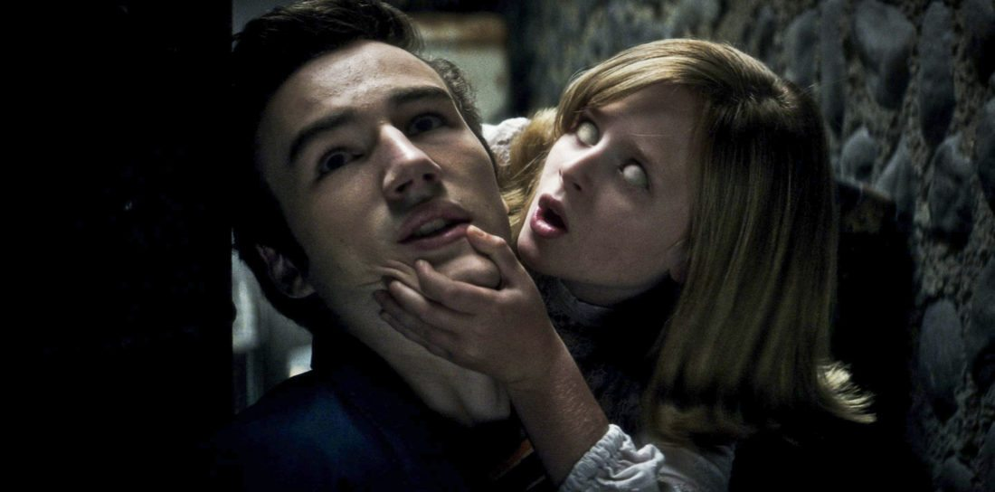 "PARKER MACK as Mikey is attacked by LULU WILSON as Doris in ""Ouija: Origin of Evil.""  Inviting audiences again into the lore of the spirit board, the supernatural thriller tells a terrifying new tale as the follow-up to 2014Õs sleeper hit that opened at No. 1.  In 1965 Los Angeles, a widowed mother and her two daughters add a new stunt to bolster their sŽance scam business and unwittingly invite authentic evil into their home.  When the youngest daughter is overtaken by the merciless spirit, this small family confronts unthinkable fears to save her and send her possessor back to the other side."