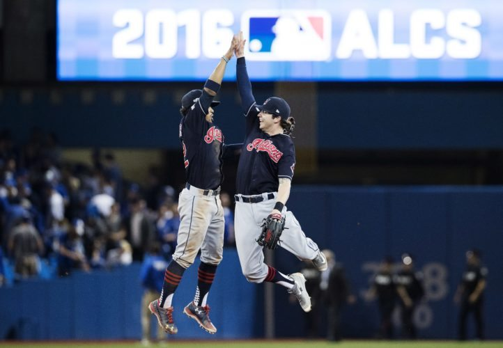 Cleveland Indians shortstop Francisco Lindor, left, and centre fielder Tyler Naquin celebrate after defeating the Toronto Blue Jays in game three of the American League Championship Series baseball action in Toronto on Monday, Oct. 17, 2016. (Mark Blinch/The Canadian Press via AP)