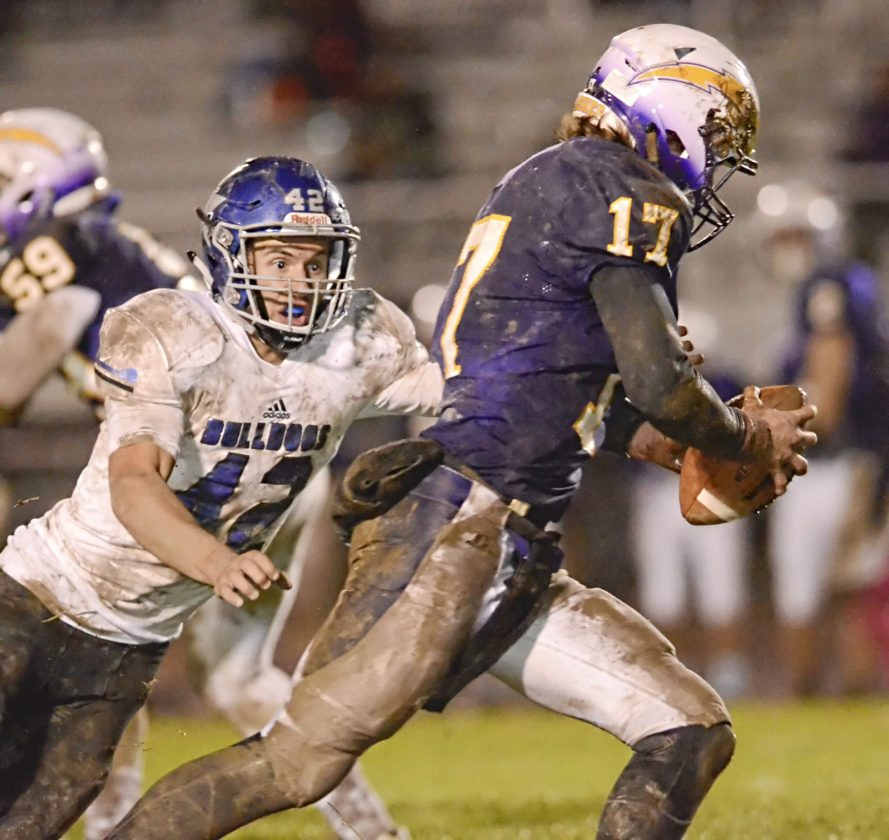 Tribune Chronicle / R. Michael Semple Lakeview's #42 Kevin Bayus, left, pressures Champion's QB #17 Brandon Allen in the backfield during first-half action.