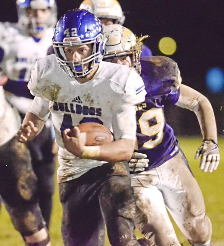 Tribune Chronicle / R. Michael Semple Lakeview's Kevin Bayus breaks through Champion's defense and rushes into the end zone for a score during Friday's game in Champion.