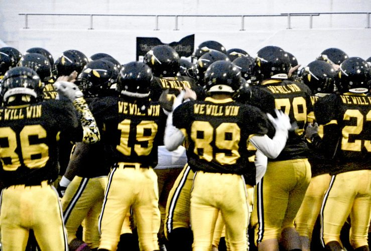 Tribune Chronicle / Eric Murray Warren G. Harding players get fired up before their game against East on Friday. The Raiders won, 49-0.