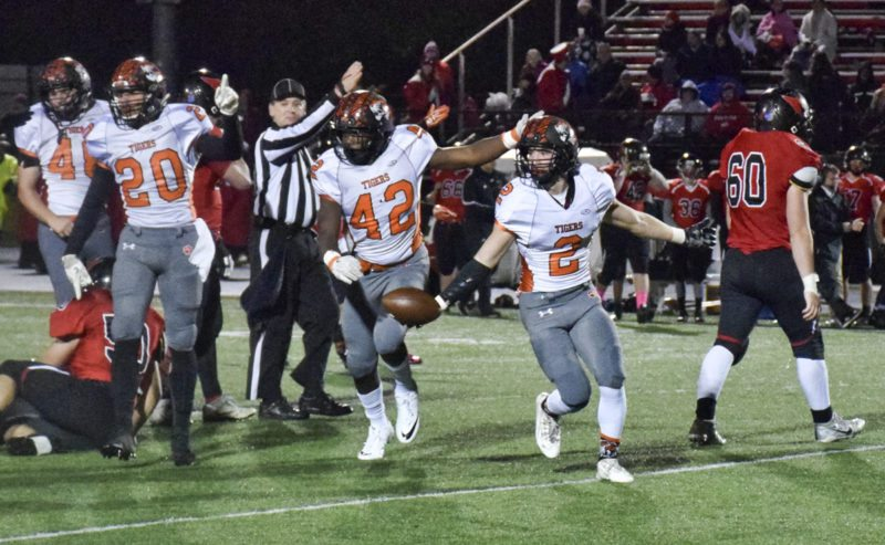 Tribune Chronicle / Doug Chapin Howland players (from left) Victor Williams and Chris Julian celebrates after George Beatty-Marsh (2) recovered a fumble during Friday's 21-0 victory at Canfield.