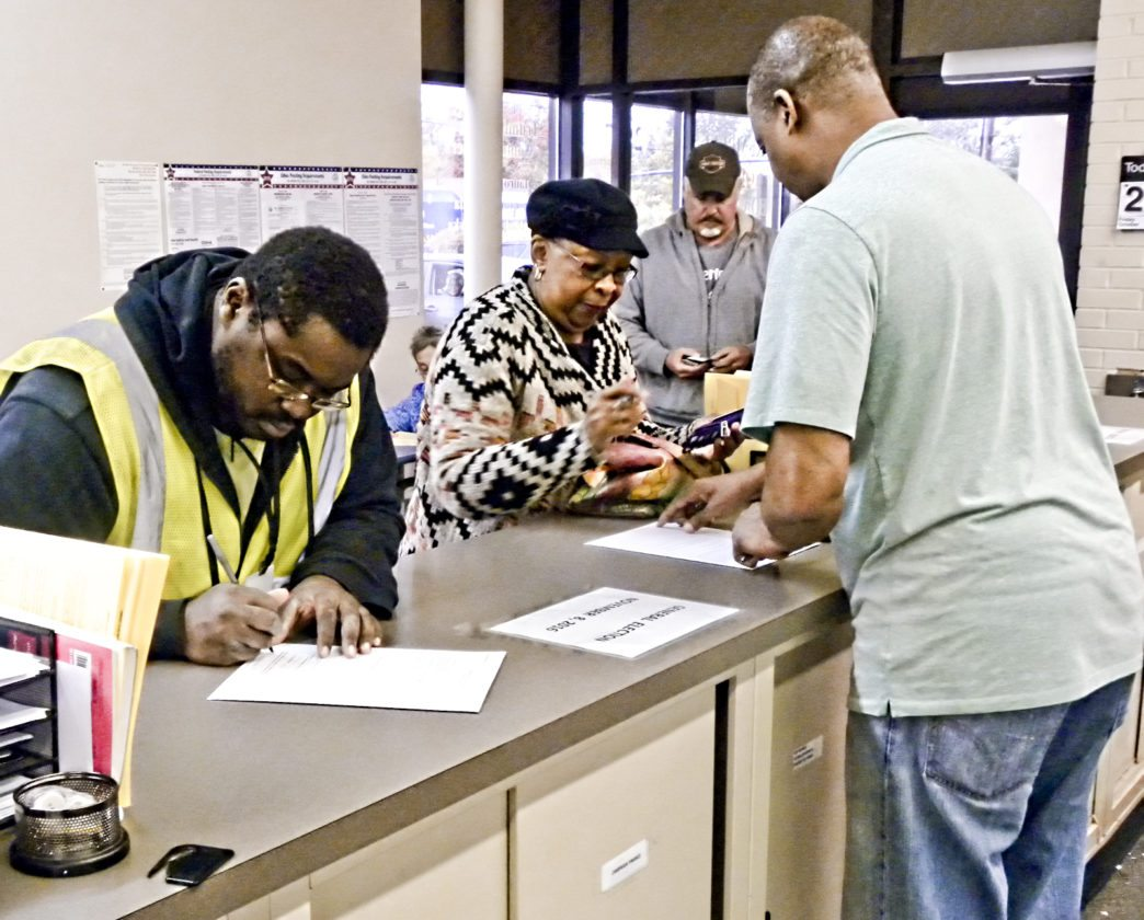 Tribune Chronicle / Raymond L. Smith Walk-in voting at Trumbull County Board of Elections are on pace as it was in 2012 and greater than it was in 2008.