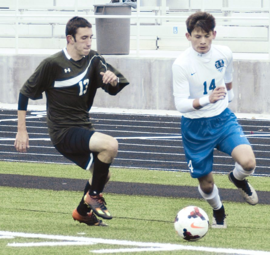 Tribune Chronicle / Bob Ettinger Blake Gill (14) of Lakeview beats West Branch defender Andy Stainer around the corner in sectional tournament action at Don Richards Memorial Stadium on Saturday afternoon.
