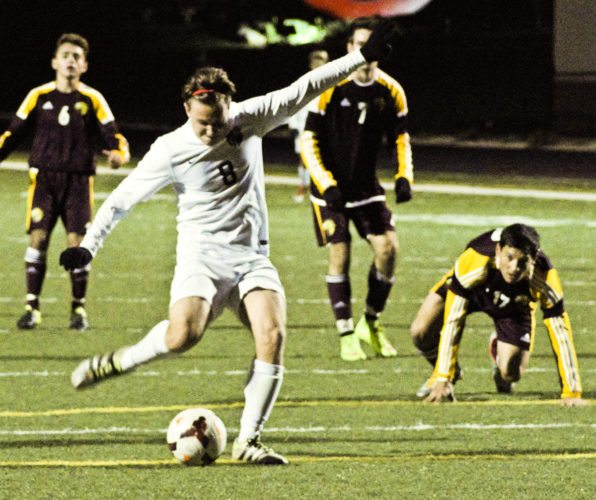 Tribune Chronicle / Bob Ettinger Christian Nogay of Howland shoots during the Tigers' 2-1 overtime loss to Walsh Jesuit Saturday in a Division I sectional game at Girard's Arrowhead Stadium.
