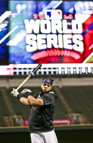 Cleveland Indians' Carlos Santana warms up during a team practice for baseball's upcoming World Series against the Chicago Cubs, Sunday, Oct. 23, 2016, in Cleveland. (AP Photo/Aaron Josefczyk)