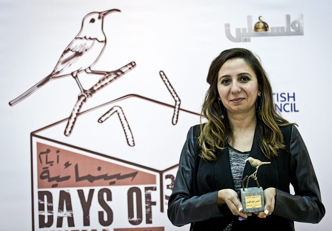 """In this Thursday Oct. 20, 2016 photo, Palestinian producer May Odeh, holds the Sunbird Short Film Award trophy for the film entitled """"Izriqaq (Blued),"""" during the Days Of Cinema awards ceremony, in the West Bank city of Ramallah. Filmlab, a Palestinian nonprofit backed by European partners, has launched a new cinema prize in an attempt to encourage the local filmmaking industry and cinema culture in the Palestinian territories. The film organization hopes the """"Sunbird Prize"""" will become the Palestinian version of the Oscars. (AP Photo/Nasser Nasser)"""